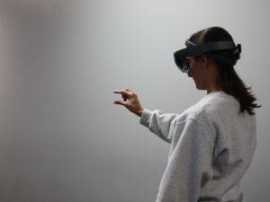 EMT Cadet using Microsoft Hololense to explore a virtual AMBUS