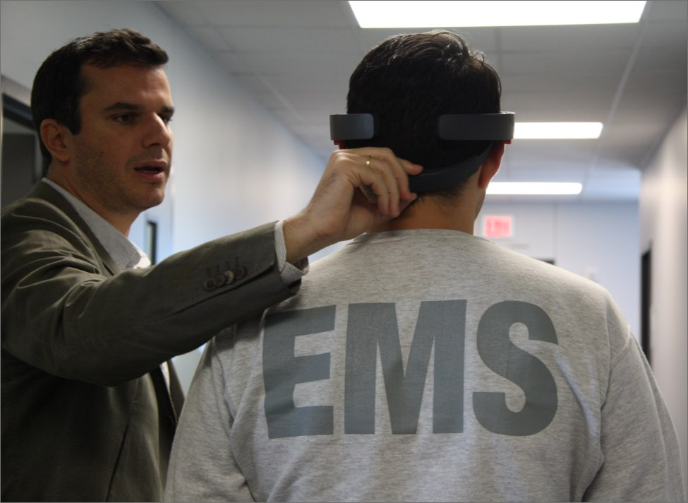 George Koutitas fitting an EMS trainee with Microsoft Hololens