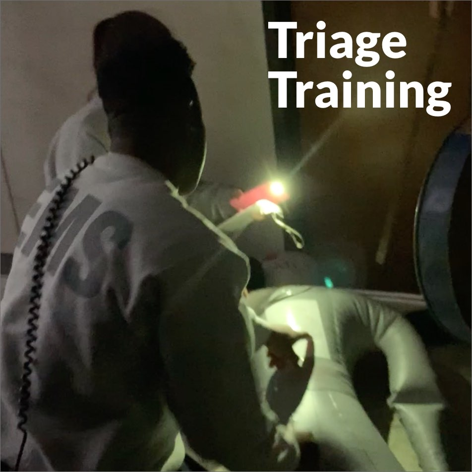two emergency medical technicians training to help people