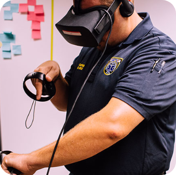 emt in uniform, wearing oculus vr goggles and pointing with hands